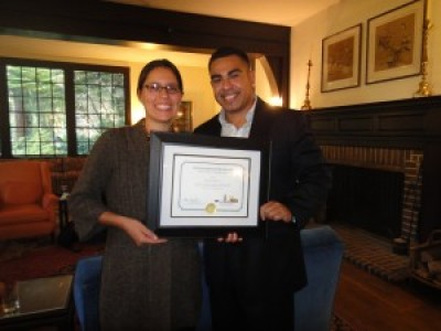 Perla receiving award